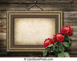Old vintage frame for photos and a bouquet of red roses