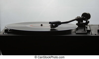 Old vintage gramophone playing lp vinyl record