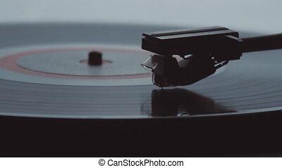 Old vintage gramophone playing lp vinyl record