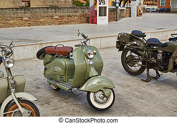Old Vintage green motorcycle on the streets of Italy,...