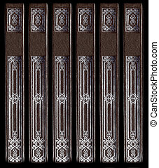 Old vintage leather book spines with silver decorative...
