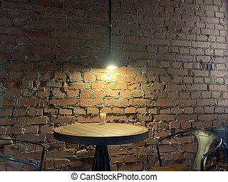 old vintage loft brick wall lamp and table
