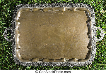 Old vintage metal tray platter with ornament
