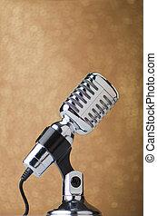 Old vintage microphone on background
