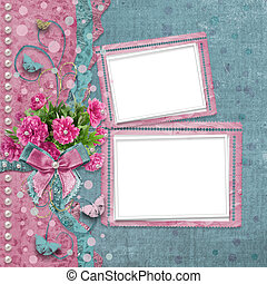 Old vintage photo album with beautiful pink peonies