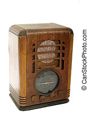 Very worn, dusty, and well-used vintage classic wood tabletop radio with a retro look. Shot isolated on white background.