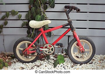 Old vintage red children's bicycle.