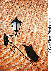 old vintage retro street lamp on brick wall with copy space back
