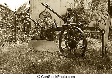 Old Vintage Rustic Agriculture Plow in Backyard