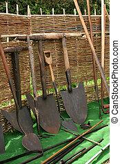 Old Vintage Shovels - Old vintage iron shovels with wooden...