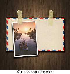 Old vintage style envelope and postcard on wood background