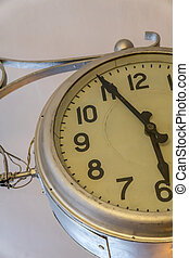 old vintage style round clock hanging on the wall