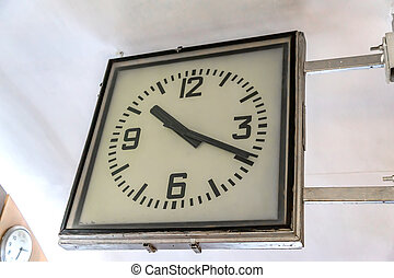 old vintage style square clock hanging on the wall