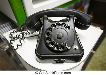 Old vintage telephone with rotary dial numbers