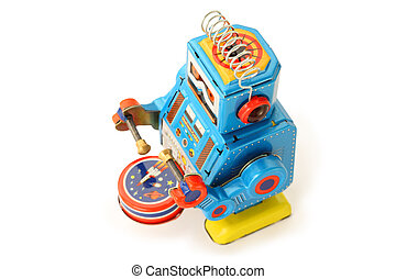 Old vintage tin robot with drum and sticks on white...