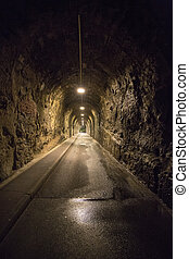 Old vintage tunnel in Biarritz at night