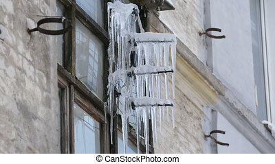 Old vintage TV antenna covered with lots of icicles in...