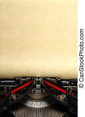 Old vintage typewriter with blank paper