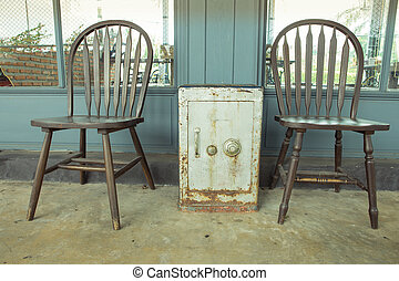old vintage wooden chair with security box tablr