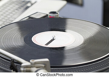 Old vinyl record spinning on turntable