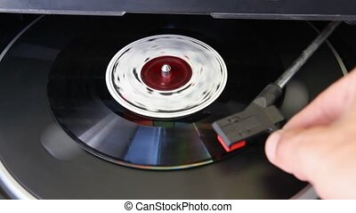 old  vinyl record  - Vinyl record spinning on turntable