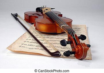 Old violin and vintage music sheet make an elegant still life.