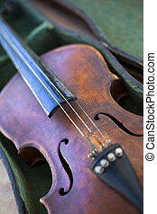 Old violin without a rope in a flea market