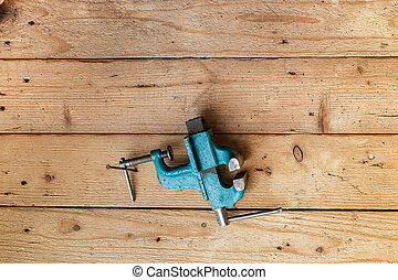 Old vise hanging on the wall