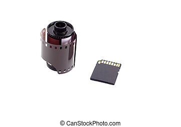 Roll of film next to digital memory card