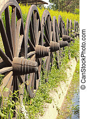 Old wagon wheels arranged in a fence.