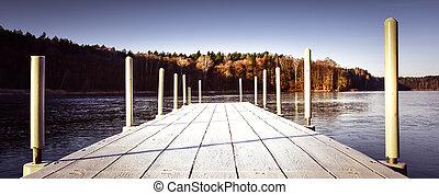Old Walking Wooden Bridge on a Frozen Lake