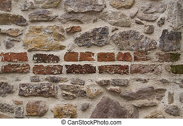 Old wall from stones bricks different colors