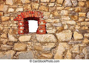 Old wall of castle with a window