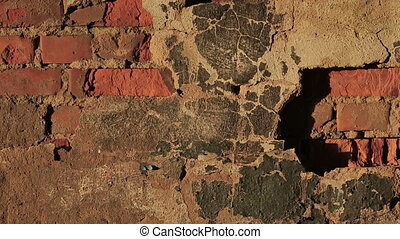 Old wall of red brick and the destruction of plaster. Video...