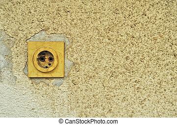 old wall-plug on cranied plaster