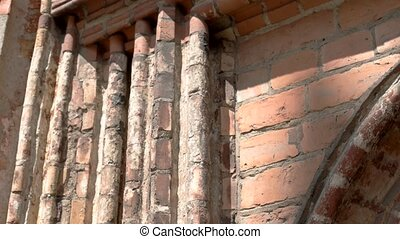 Old wall under sunlight. Aged and dirty bricks. Legacy of...