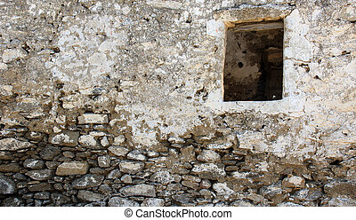 Old  wall with a window hole