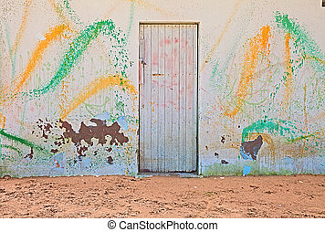 old wall with colored spray of paint