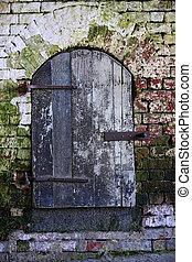 Alcatraz - Old wall with wooden door at Alcatraz Island Jail...