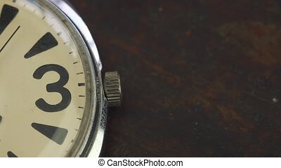 Old watch lies on the table