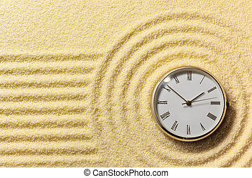 Old watch on surface of golden sand - Old round watch on a ...
