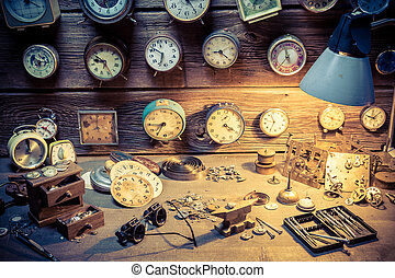 Old watchmaker's workshop with many clocks