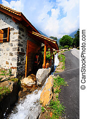 Old Water Mill At The Foot Of The Italian Alps