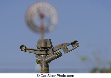 Old water springer against a blue sky background.