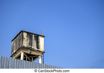 Old water tank with blue sky background