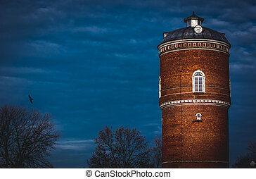 old water tower against the sky
