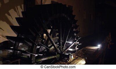 Old watermill wheel in action.