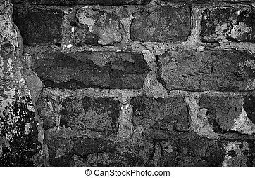 old weathered brick wall with plaster