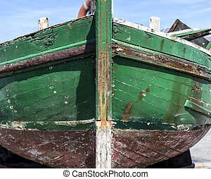 Old weathered green boat