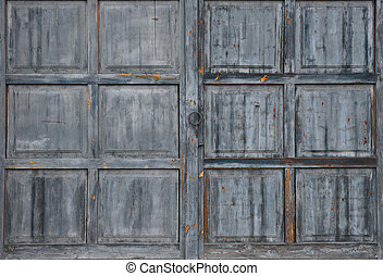 Old weathered large grey wooden gate texture